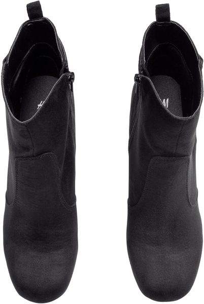 h m boots with a wedge heel in black lyst