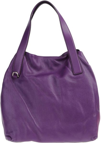 coccinelle shoulder bag in purple lyst. Black Bedroom Furniture Sets. Home Design Ideas