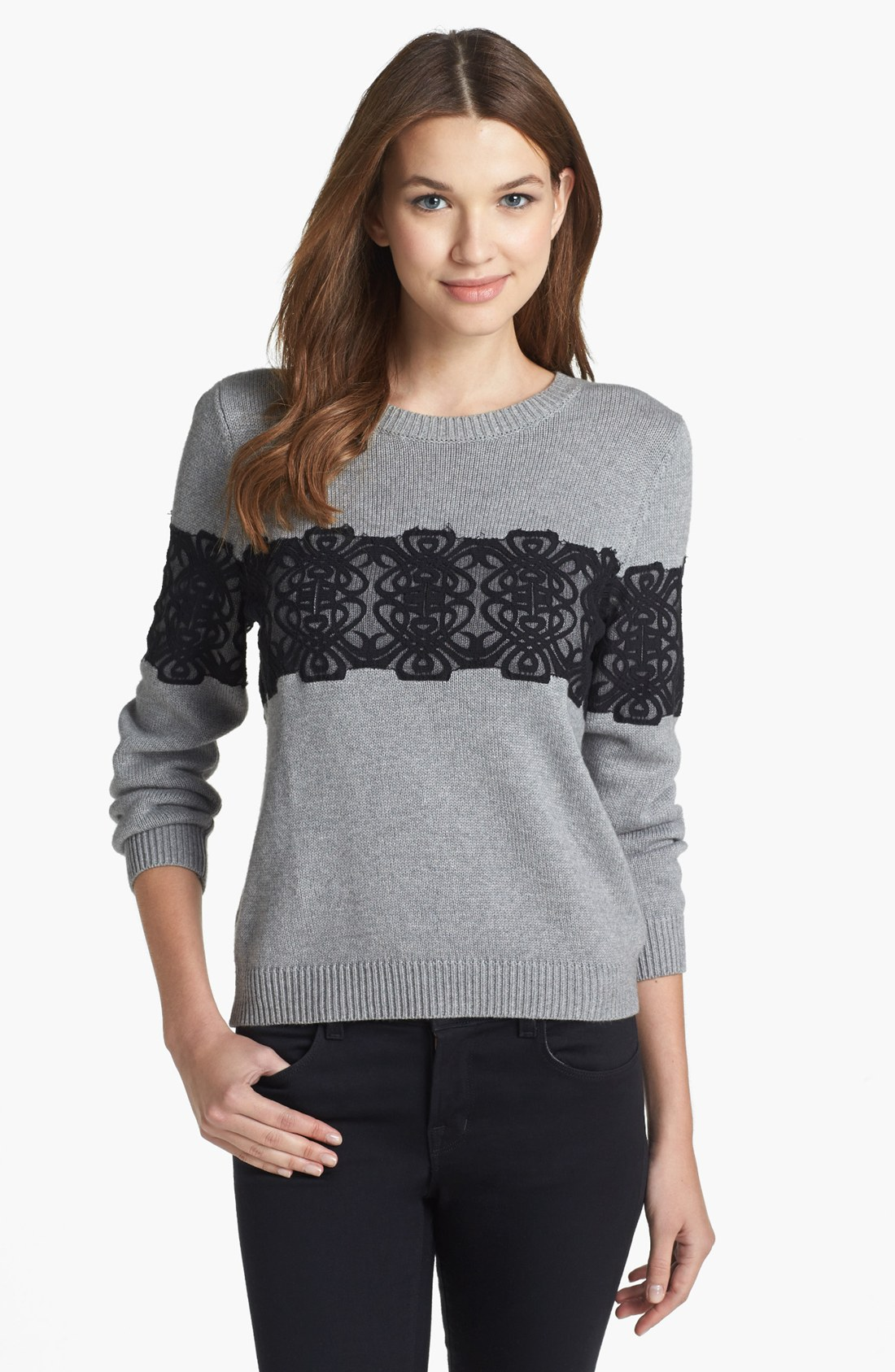 With a modern twist on a classic sweatshirt, this comfy top will turn heads everywhere you go. Embellished with beautiful pearls, this piece will deliver chart-topping style.