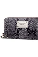 Michael Kors Large Multi Function Phone Case - Lyst