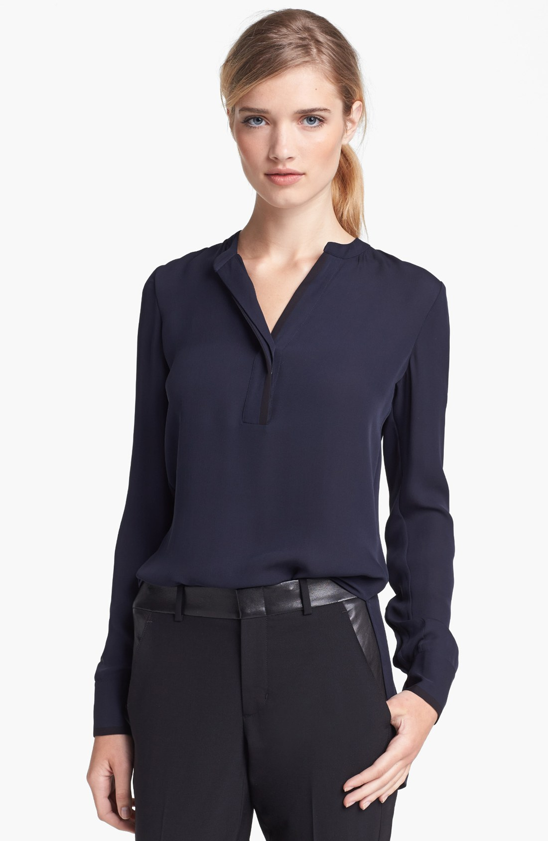 The ladies Hostess Satin Blouse from Sharper Uniforms conveys a high-end look that's polished, yet understated. It includes a button-down front, faux enamel buttons and a gentle collar. The long sleeve satin blouse is flattering on a variety of body types and offers maximum comfort with lightweight, breathable materials.