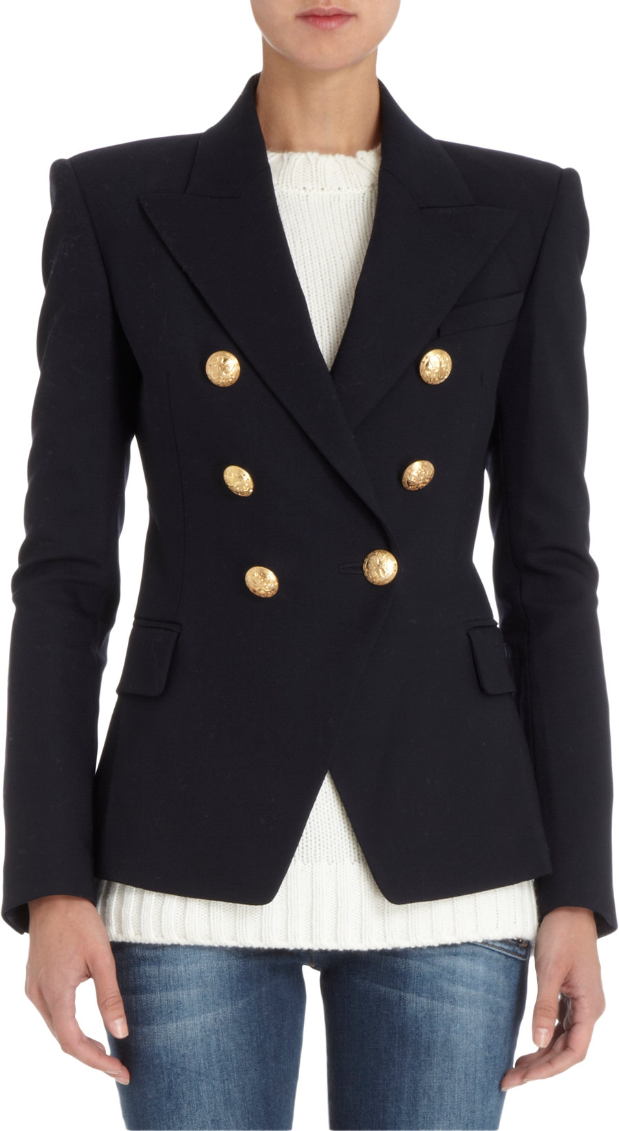 A blazer is a type of jacket resembling a suit jacket, but cut more casually. A blazer is generally distinguished from a sport coat as a more formal garment and tailored from solid colour fabrics. Blazers often have naval-style metal buttons to reflect their origins as jackets worn by boating club members.