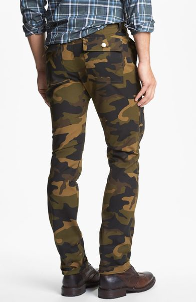 Mens Camo Pants. The battle for cool casual clothing ends with men's camo pants. From chinos to cargos, check out these laid-back bottoms in this attention-grabbing print. I.N.C. Men's Slim-Fit Camo Pants, Created for Macy's True Religion Men's Big T Camo Slim Sweatpant.