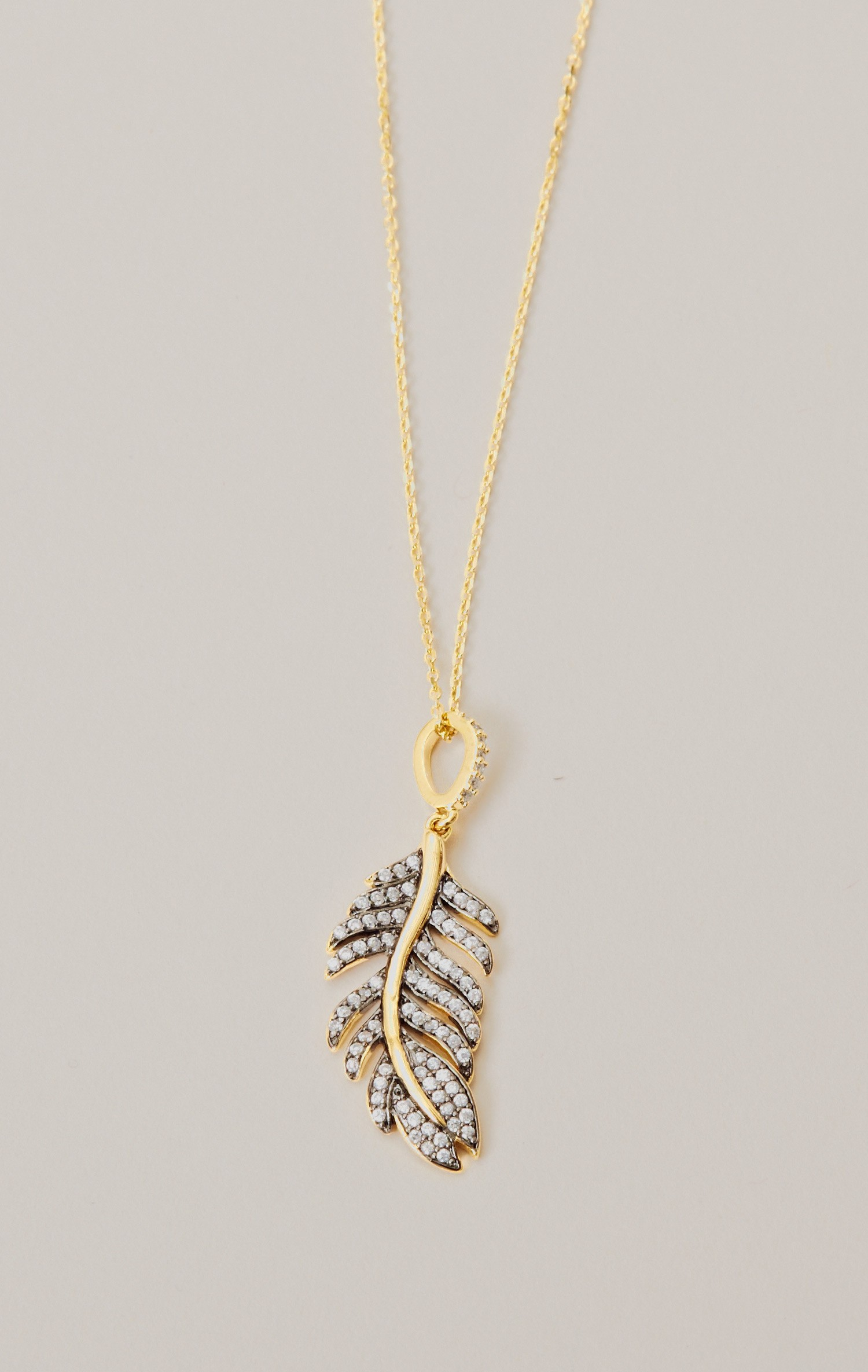 Tai Rhinestone Feather Charm Necklace In Gold Lyst
