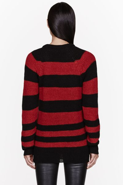 Twintip black knitted round neck jumper, with red and white stripes. The hems of the body and arms ifeature a finer knit that the rest of the body. Topshop Ladies Red And White Striped Jumper Black Sequinned Flower & Key Motif.