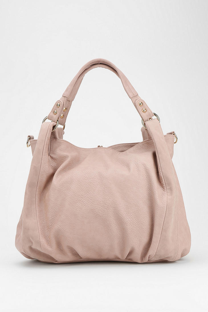 Urban outfitters Ecote Tasseled Vegan Leather Hobo Bag in Pink | Lyst
