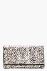 Saint Laurent Taupe Metallic Leather Foldover Letters Clutch - Lyst
