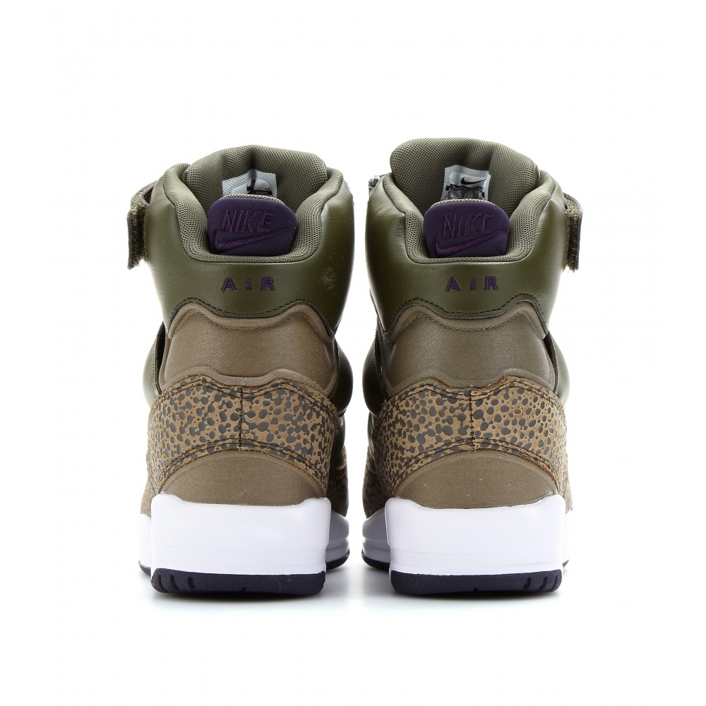 the latest a5a31 c5baf Lyst - Nike Air Revolution Sky Hi Wedge Sneakers in Brown