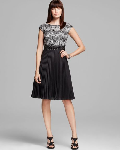 unger lace top pleated skirt dress in black white