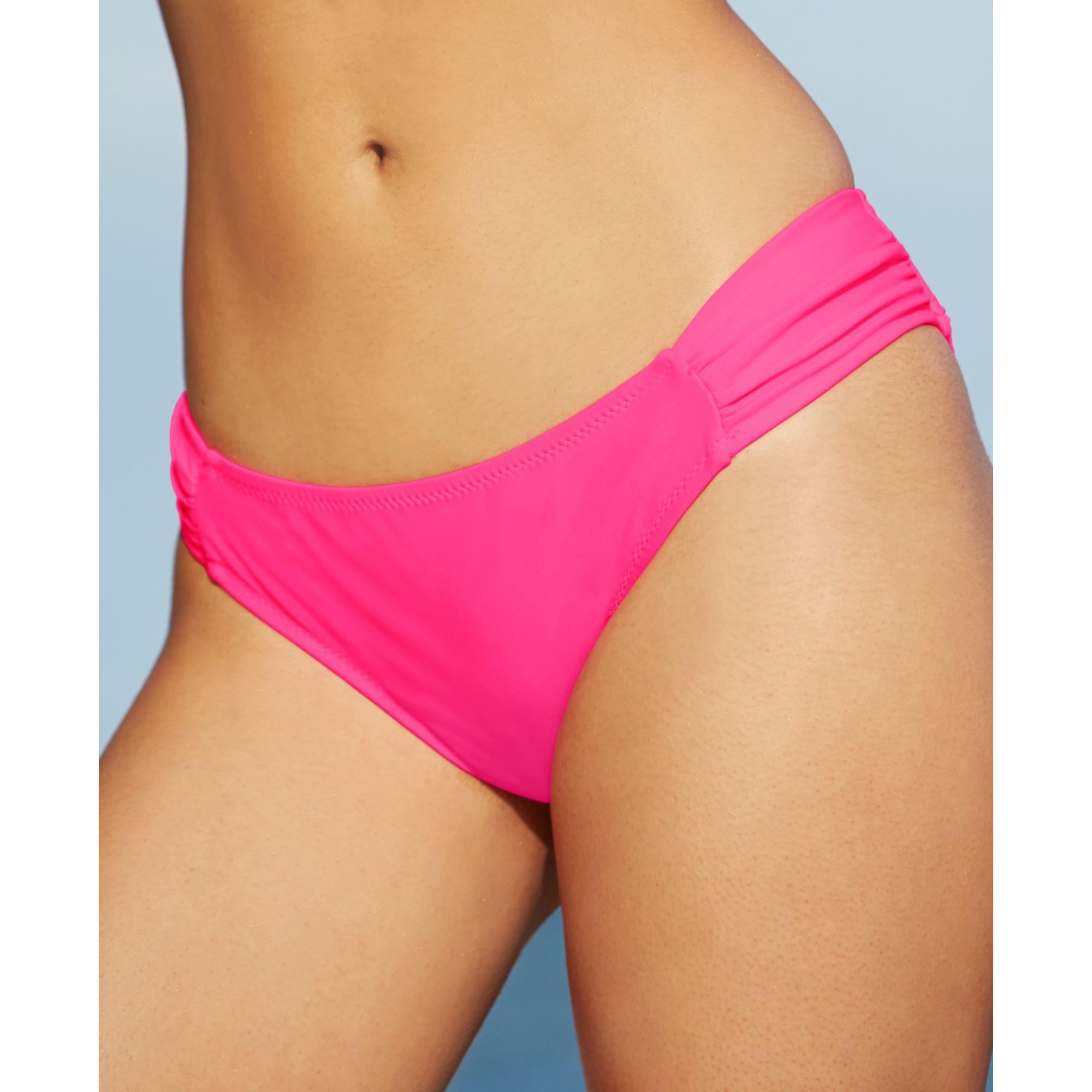 Side bikini the pulls bottoms girl to