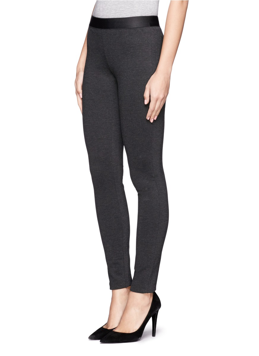 Joseph Ribkoff's floral jacquard print pixie pant has a comfortable stretch fit with slip-on midrise waist in addition to the zips at the ankle-length hem and tapering down the leg.