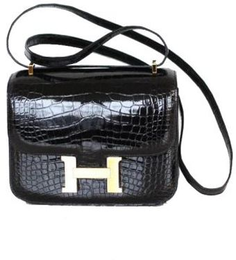 Hermes 18cm Black Shiny Crocodile Constance with Gold - Lyst