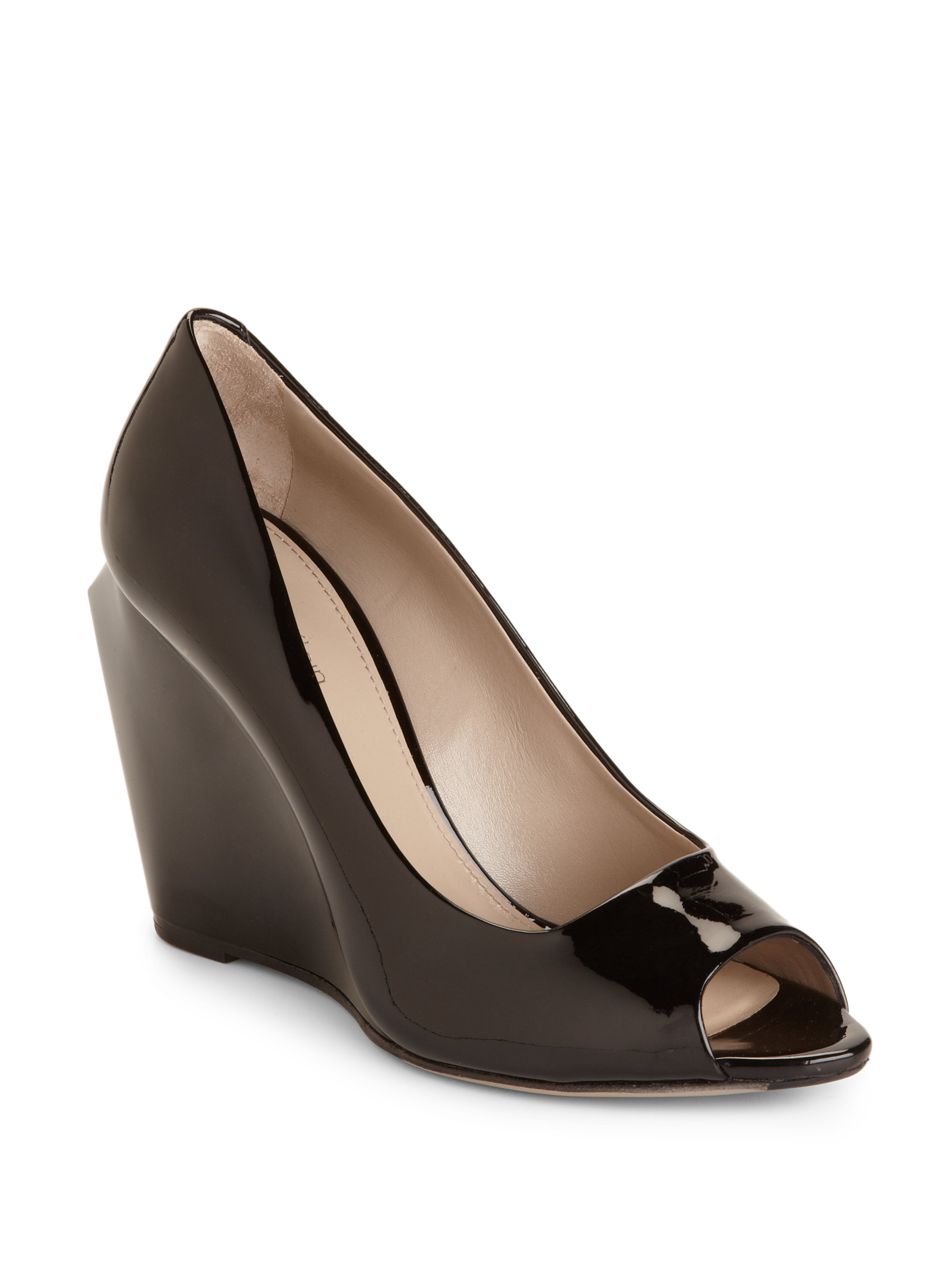 Lyst Calvin Klein Thao Patent Leather Wedge Pumps In Black