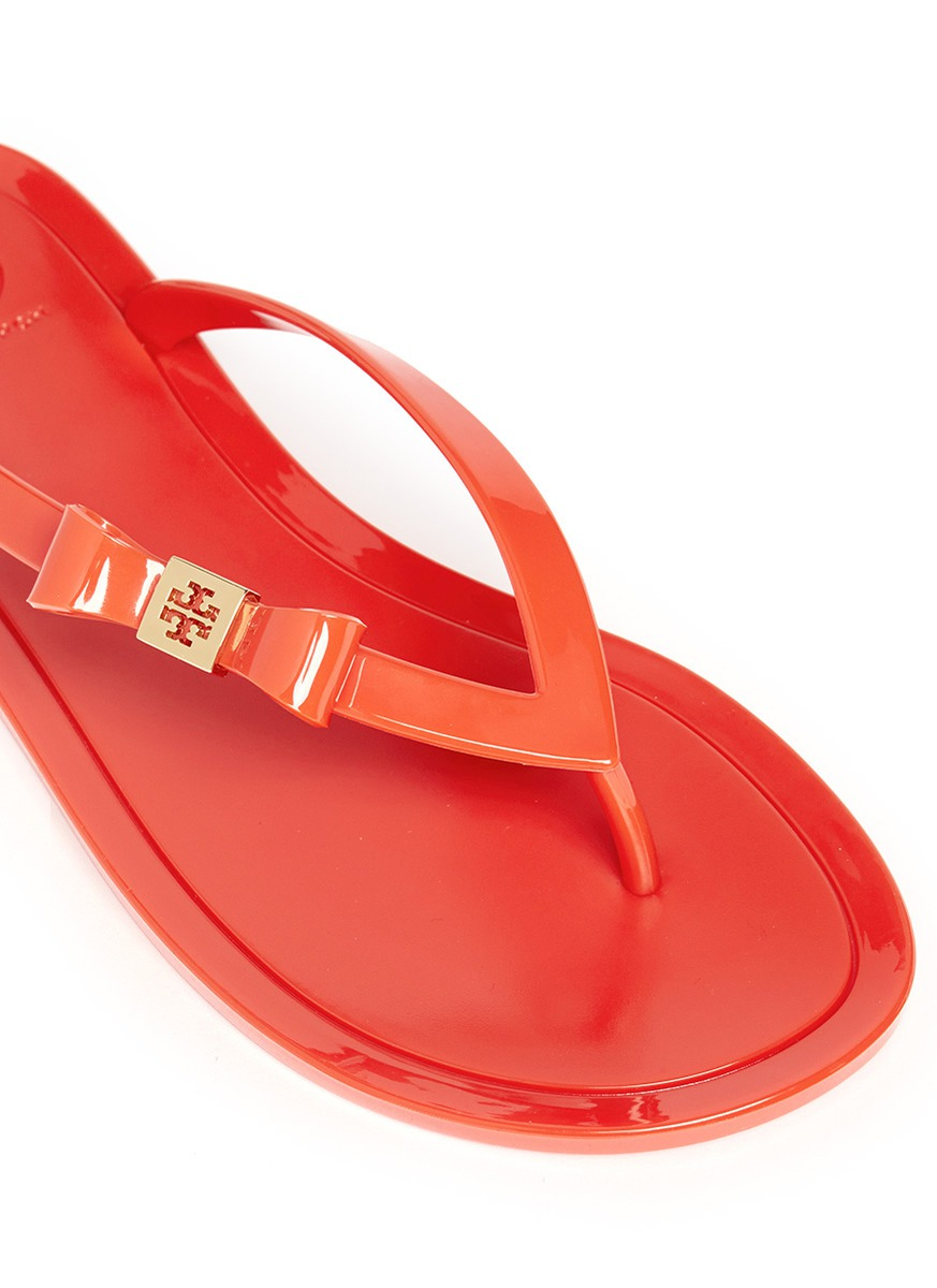 21cc54b017607 Tory Burch Michaela Bow Jelly Flip-flops in Orange - Lyst