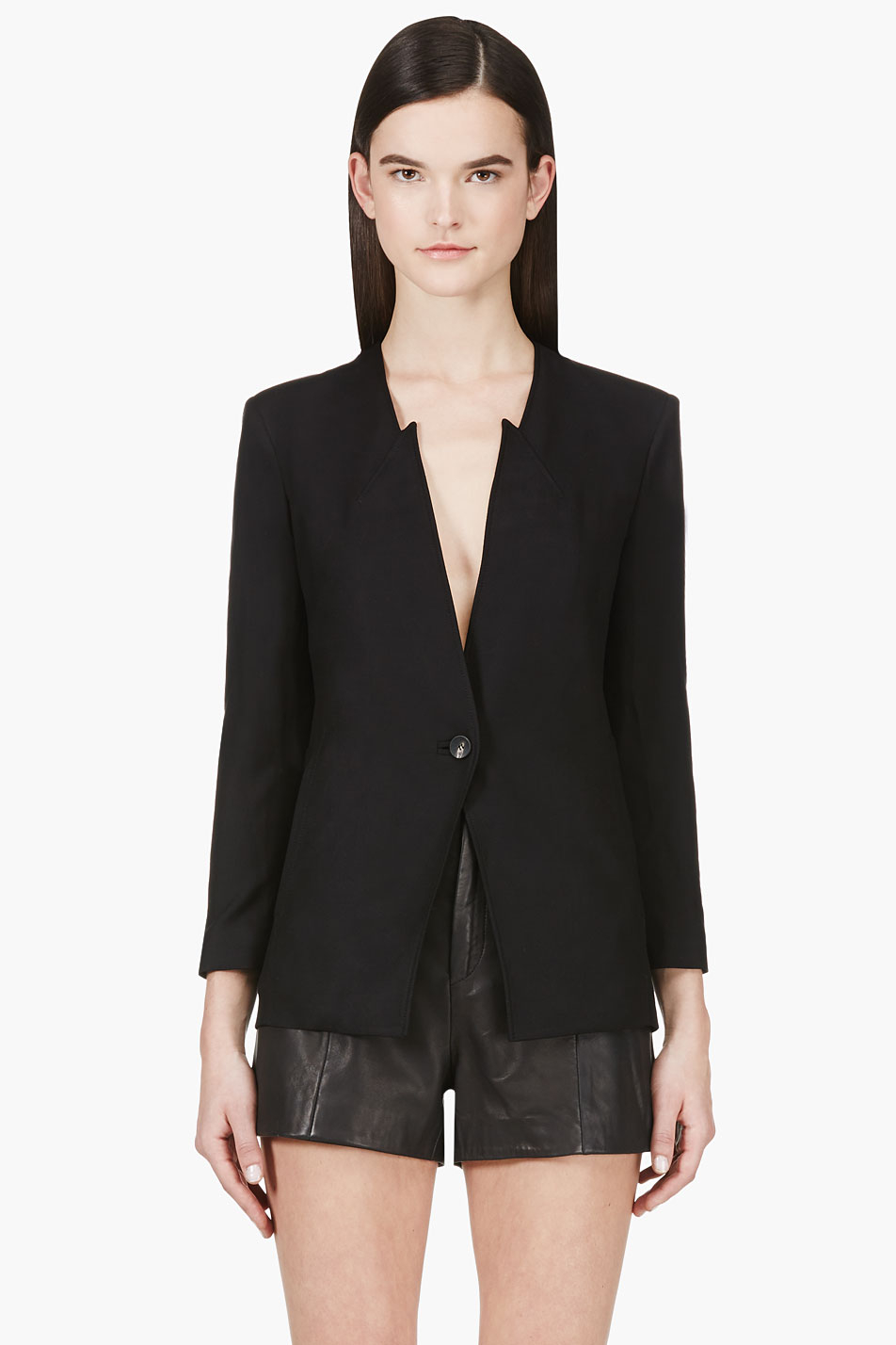 The Bohemian Traders Blazer is updated in this 'Extended' edition - meet a sleek, soft collared silhouette with exotic tassels to the hem. Made from thick sateen, it's detailed with embossed black buttons and lightly padded shoulders that balance the loose shape.