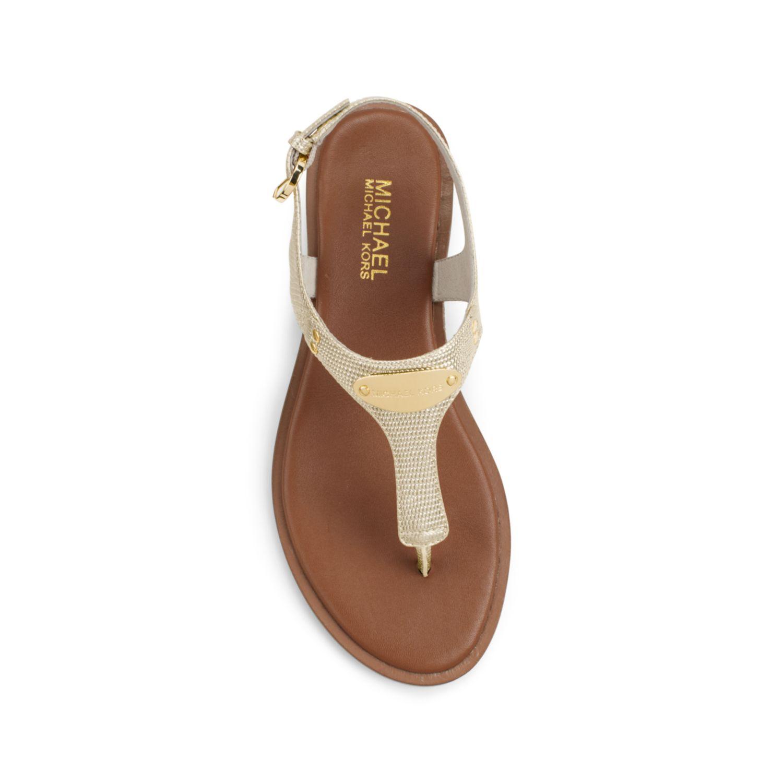 michael kors logo plaque metallic leather sandal in gold. Black Bedroom Furniture Sets. Home Design Ideas