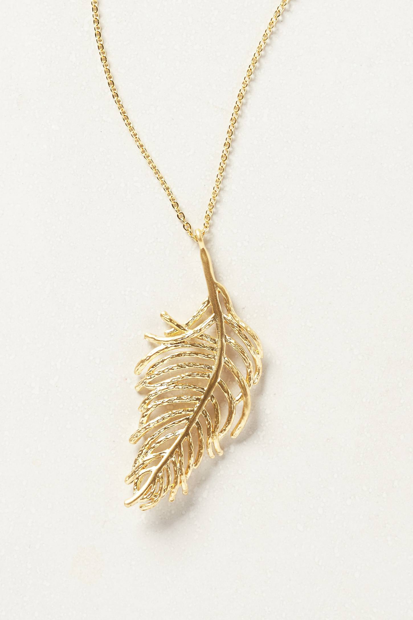 Lyst Anthropologie Golden Feather Necklace in Metallic