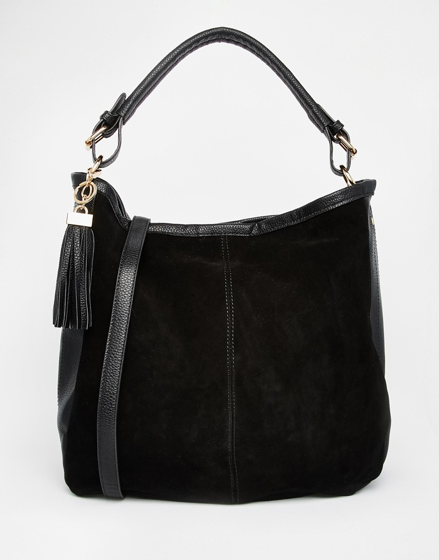 BEAUTIFUL Gucci black suede shoulder bag in excellent condition. Black monogram suede exterior trimmed with a black leather shoulder strap with a gunmetal engraved curved strap top. Snap closure opens to a black nylon lined interior that holds ample storage space and a side zippered pocket for added organization.