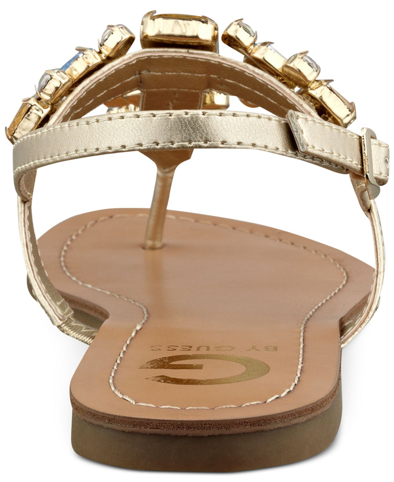 1606df22b Lyst - G by Guess Women S Kyli T-Strap Flat Thong Sandals in Metallic