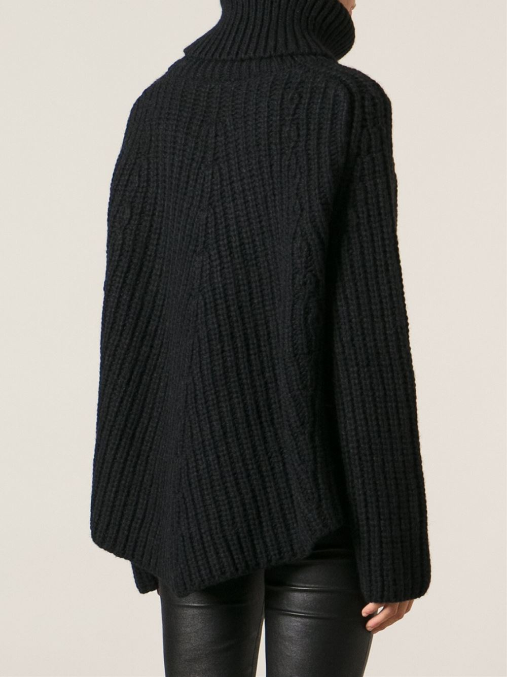 Chunky Sweater from Prada: Black Chunky Sweater with round crew neck, long sleeves, knitted details, ribbed cuffs and hem. Composition: 67% Mohair, 30% Polyamide, 3% Wool more More like this.