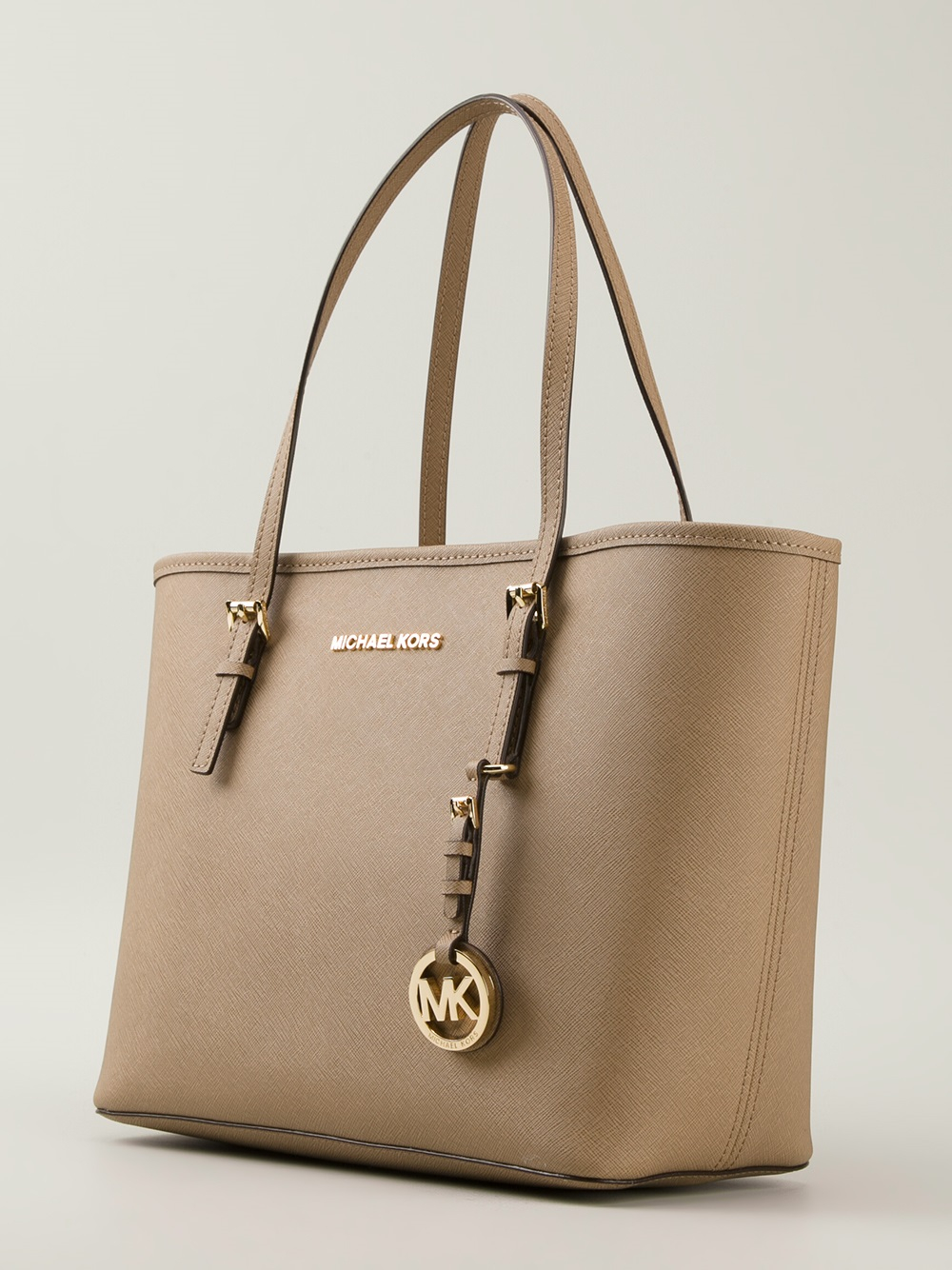 e1d52280db89 ... usa michael michael kors jet set tote in brown lyst 3a4da 17fe0