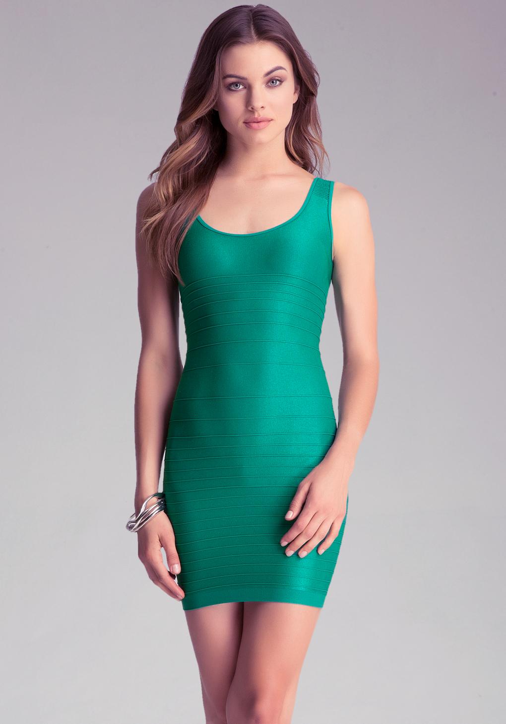 Lyst Bebe Back Cut Out Shine Dress In Green