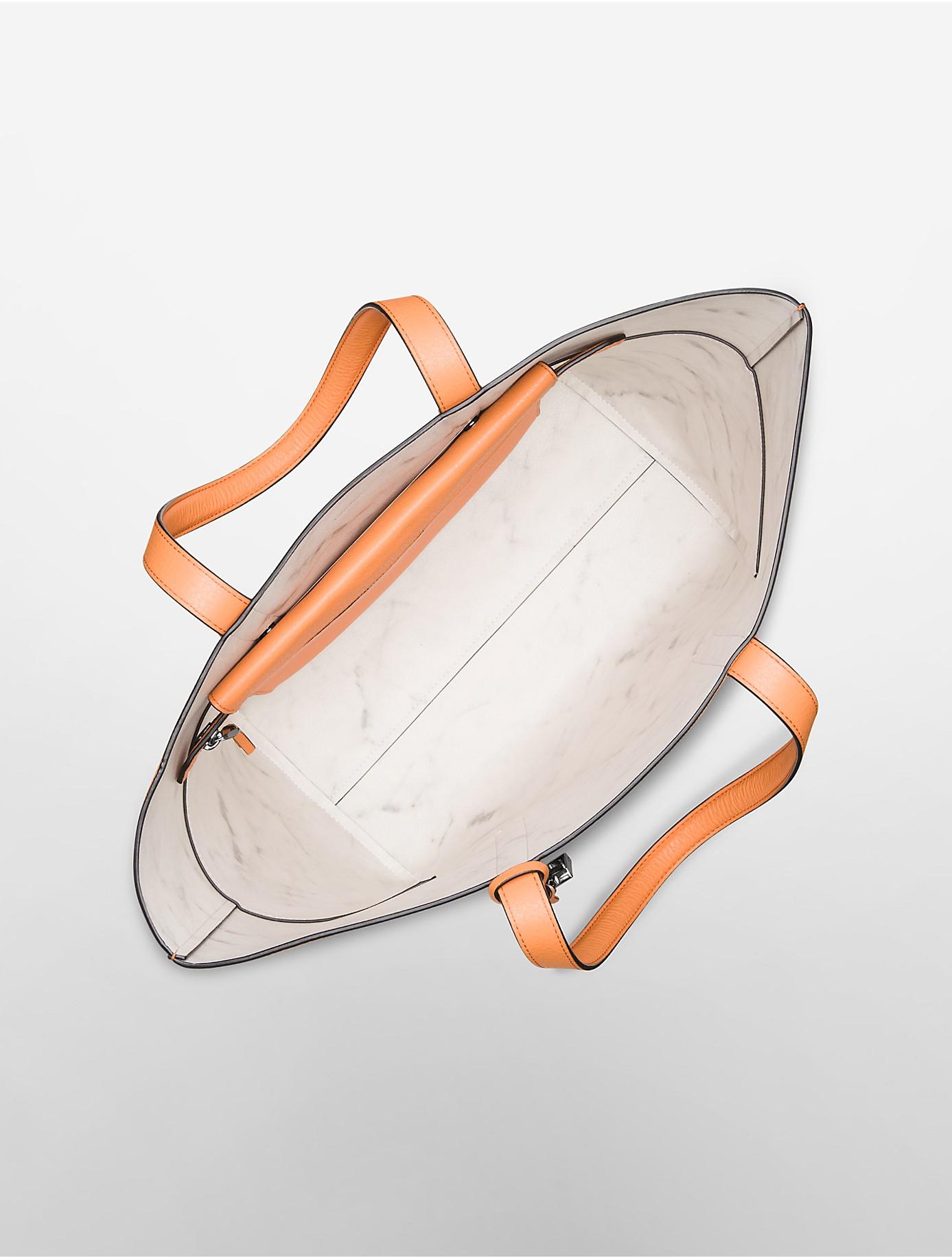 calvin klein arslyne leather shopper tote in orange lyst. Black Bedroom Furniture Sets. Home Design Ideas