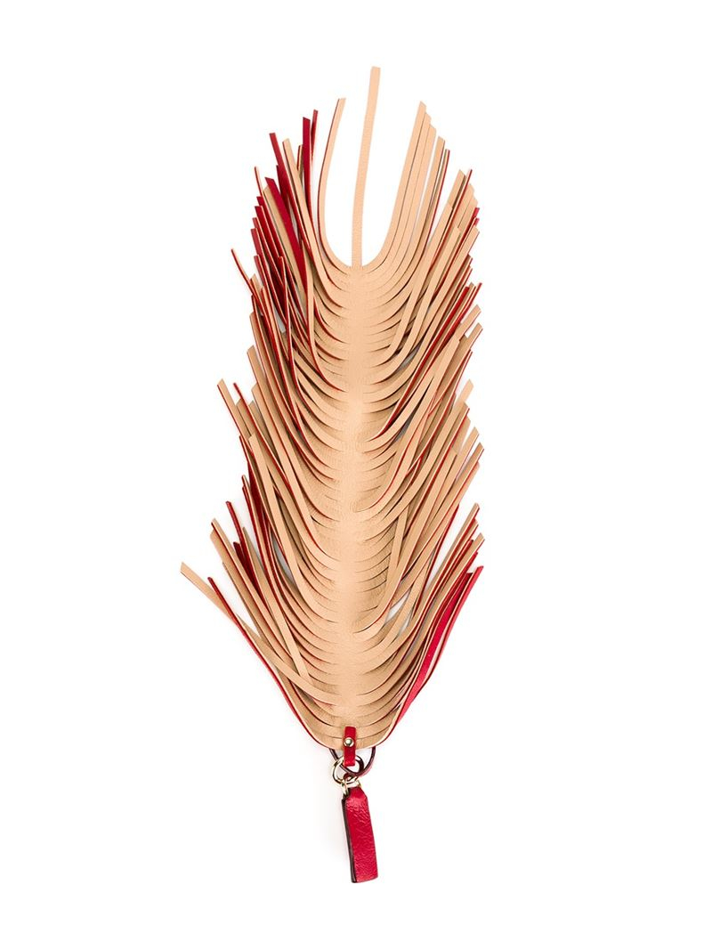 Lyst jimmy choo fringed charm in red for Jimmy s fine jewelry