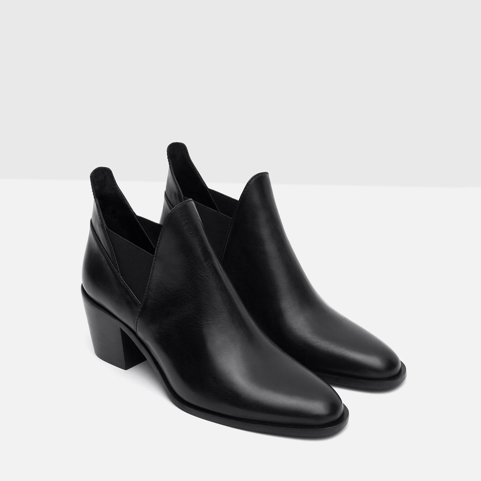 zara leather ankle boots with openings in black lyst