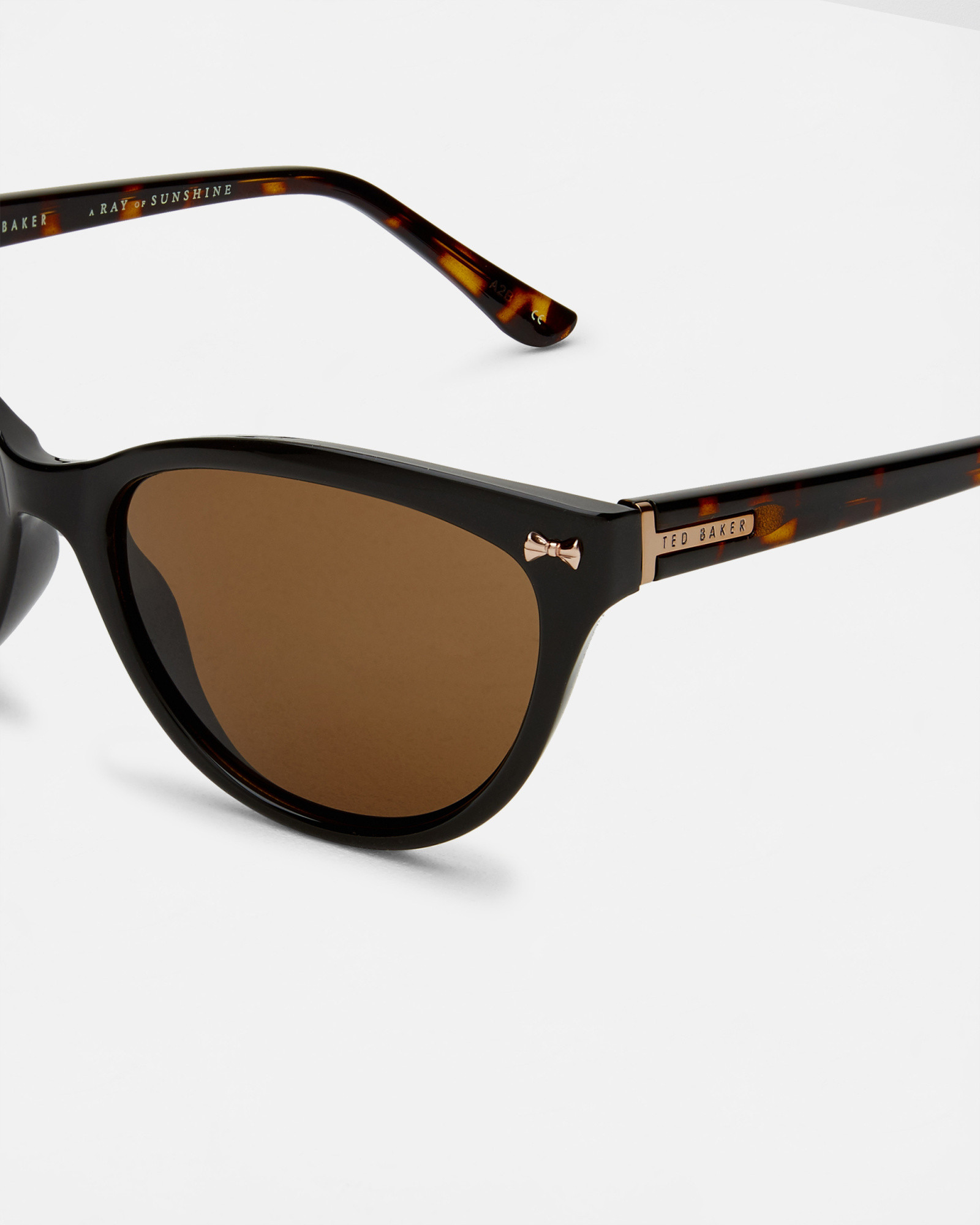bc6245aa2259 Lyst - Ted Baker Bow Cat Eye Sunglasses in Black