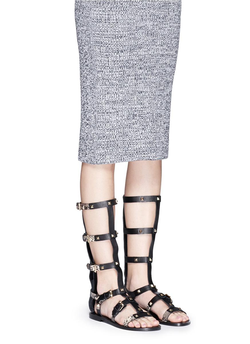 6bf1350bd93 Lyst - Ash  mykonos  Stud Calf Length Gladiator Sandals in Black
