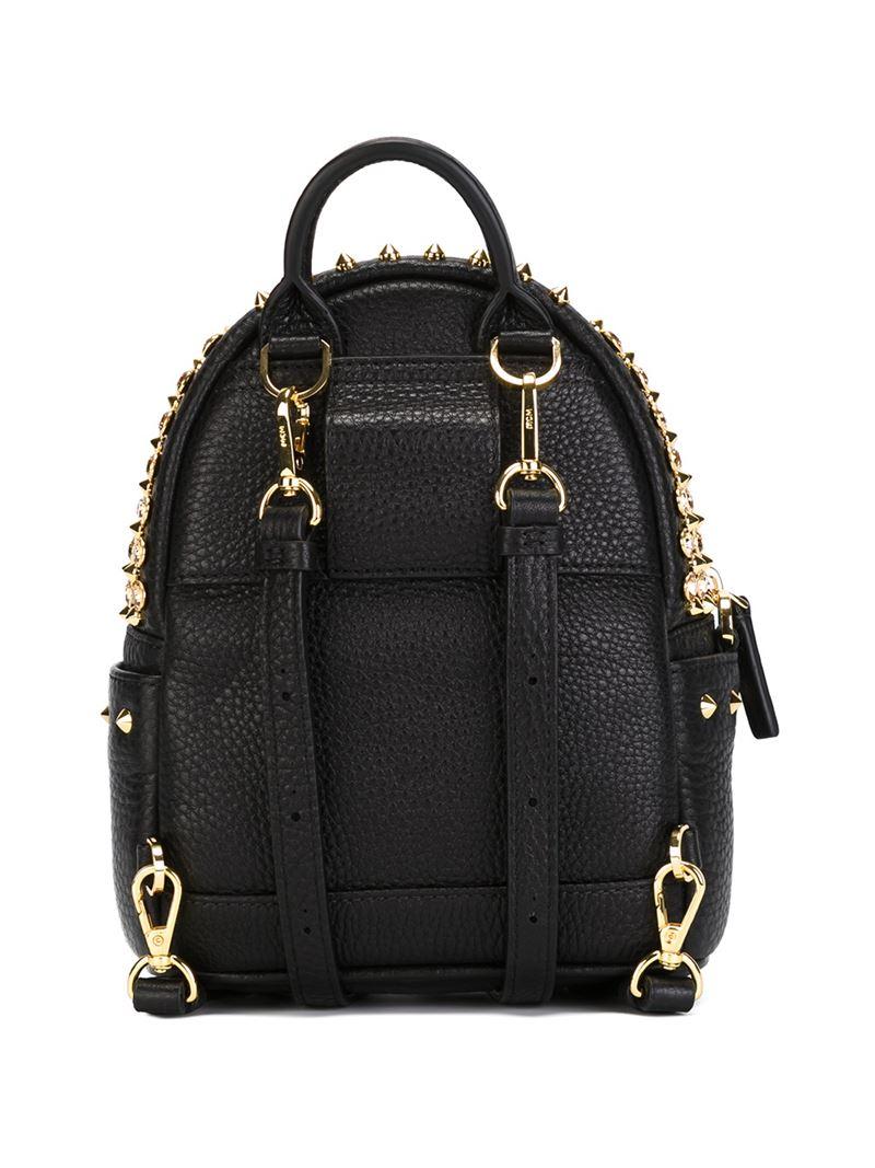 mcm mini studded backpack in gold black lyst. Black Bedroom Furniture Sets. Home Design Ideas