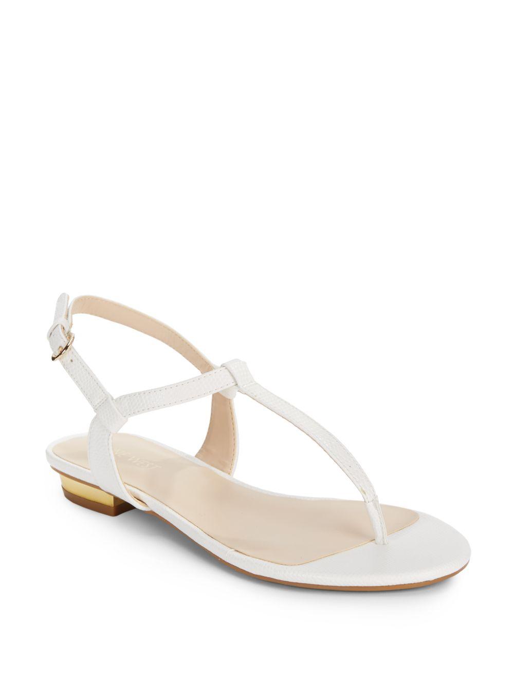 658f23669f96ea Lyst - Nine West Unlock Faux Snakeskin T-Strap Thong Sandals in White