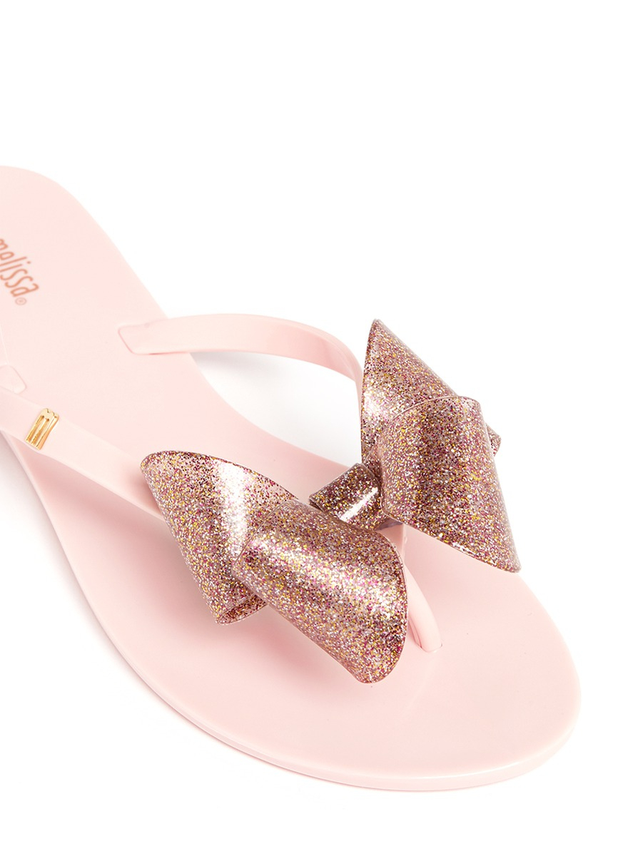 ea14833a2 Lyst - Melissa  Harmonic  Glitter Bow Jelly Flats in Pink