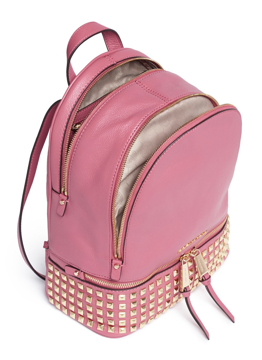 58b099a1dceb ... clearance lyst michael kors rhea small stud leather backpack in pink  04704 b7738