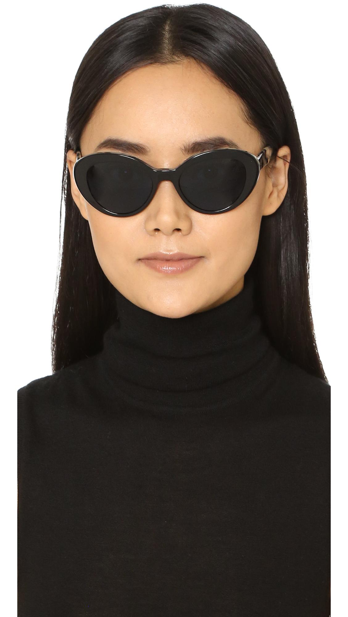 c25b50162065 spain lyst prada oval cat sunglasses in black 253df e4a83