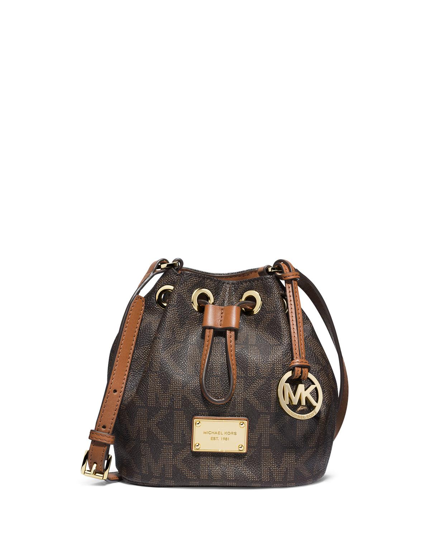 0573aff60d0977 ... inexpensive lyst michael michael kors jules logo drawstring crossbody  bag in brown 311e3 ba5d3