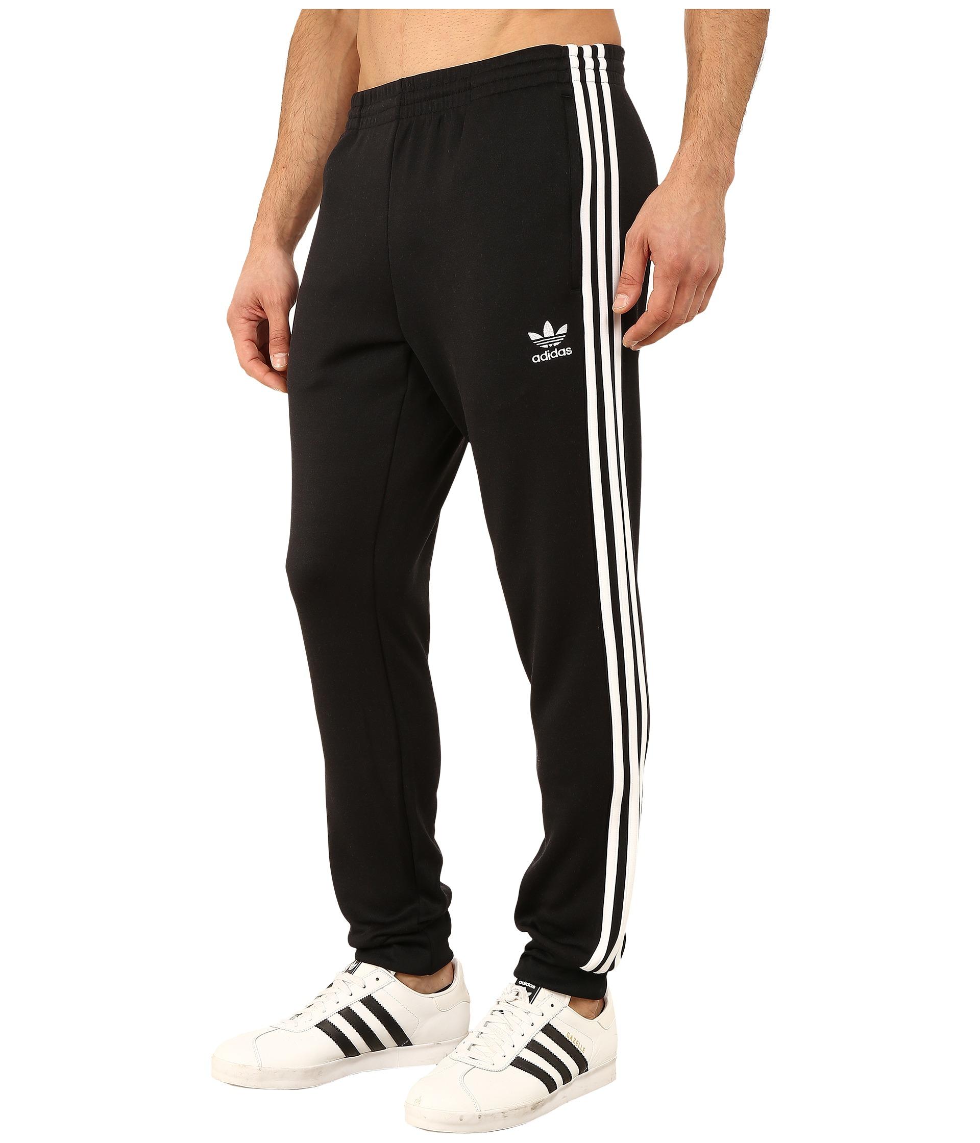 reputable site 4c3e7 8f08d Lyst - adidas Originals Superstar Cuffed Track Pants in Blac