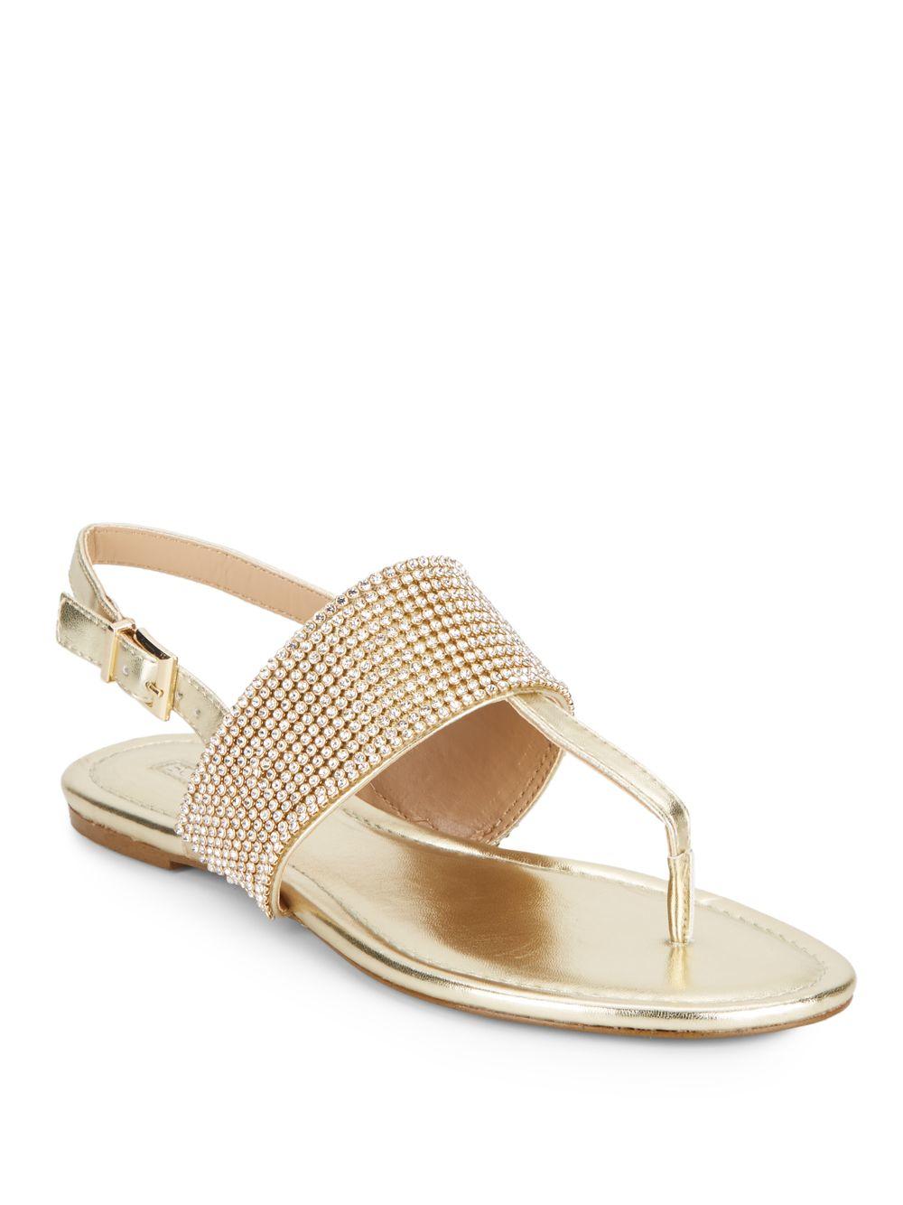 c4da2668d5caee Lyst - BCBGeneration Wander Metallic Thong Sandals in Metallic