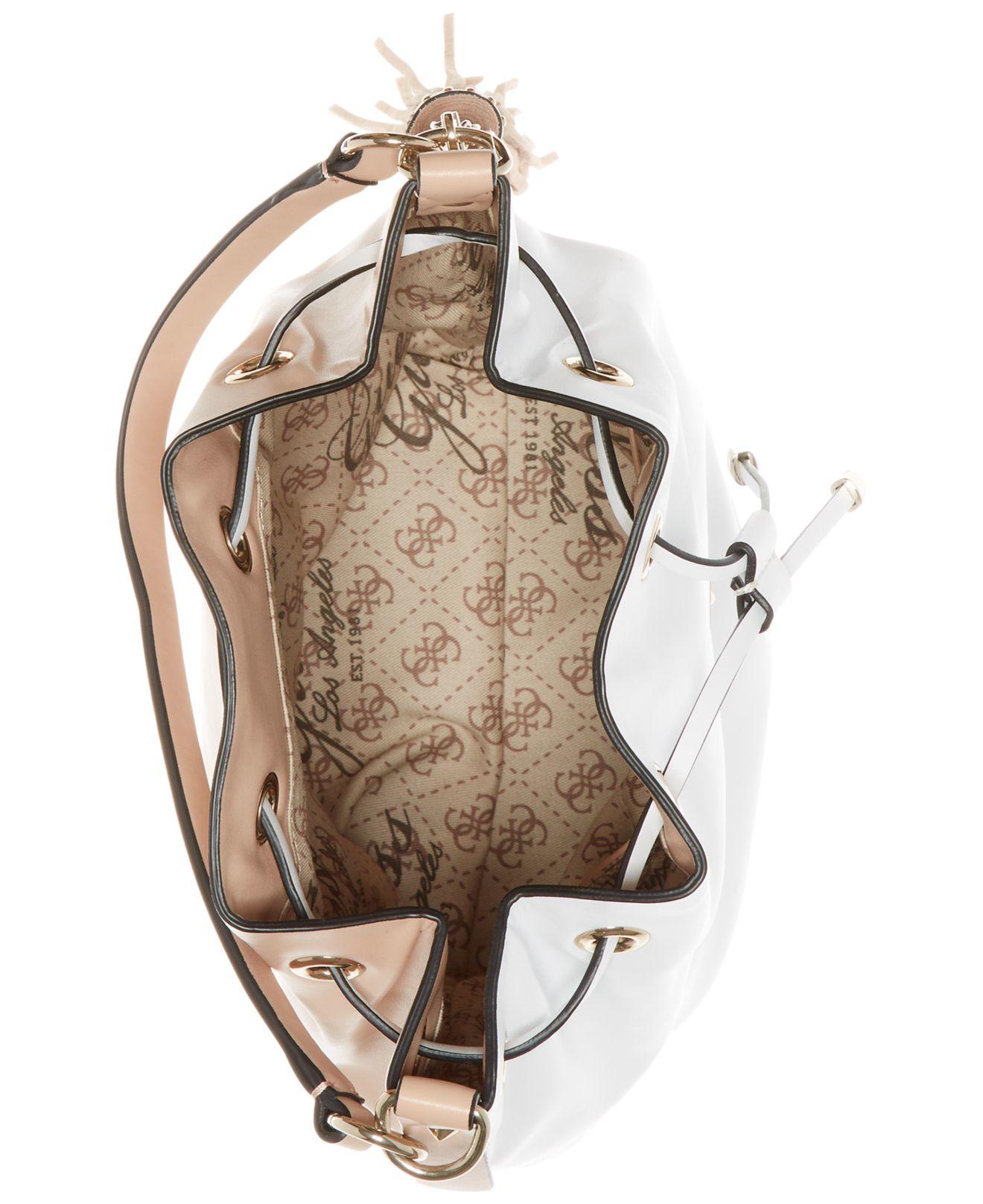 b1b94760ed Lyst - Guess Thompson Drawstring Bucket Bag in White