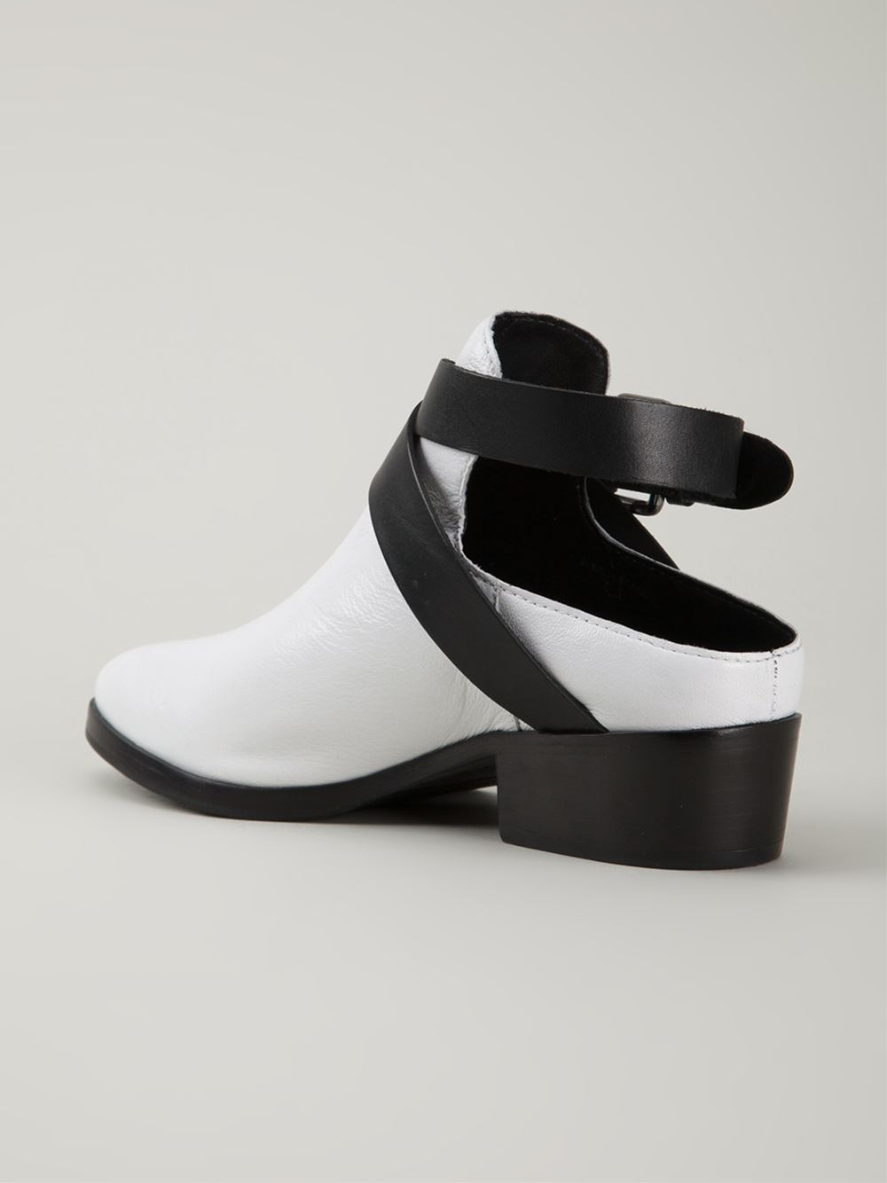 atelje71 cut out ankle boots in black white lyst