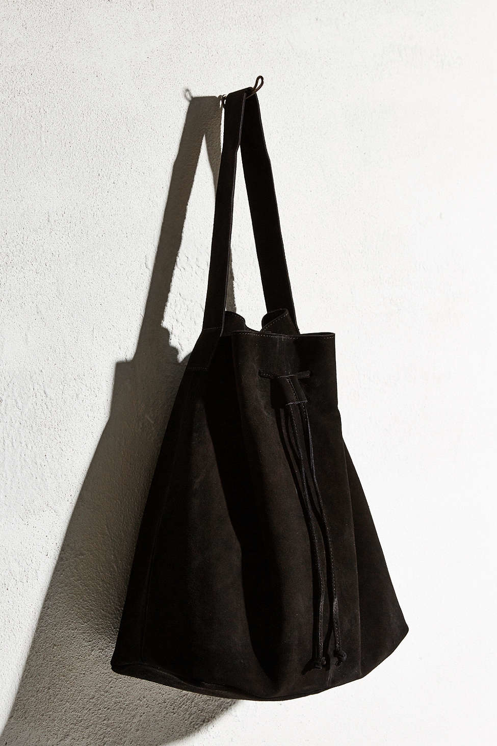 Ecote Suede Drawstring Tote Bag in Black | Lyst