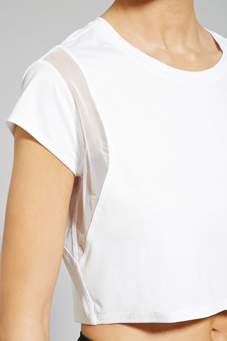 3179d0d3fd4b84 forever 21 active mesh paneled crop top in white lyst