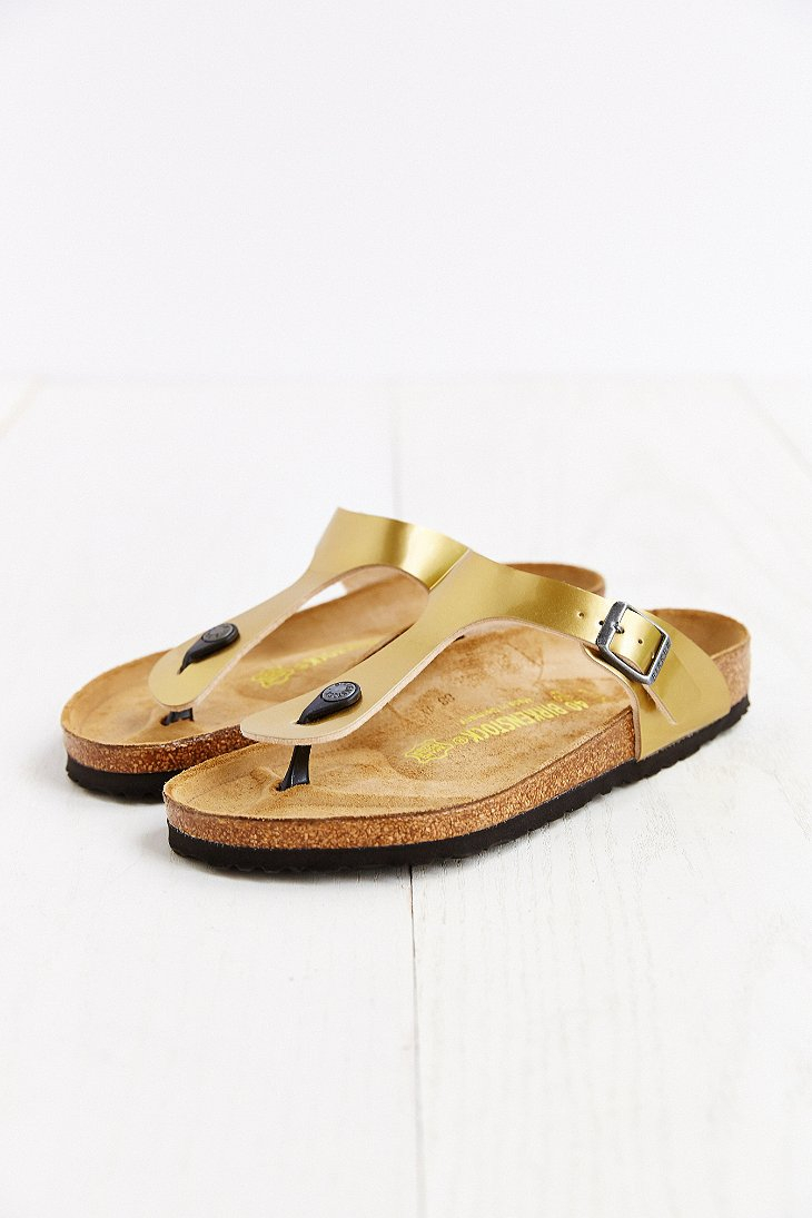 birkenstock gizeh thong sandal in gold lyst. Black Bedroom Furniture Sets. Home Design Ideas