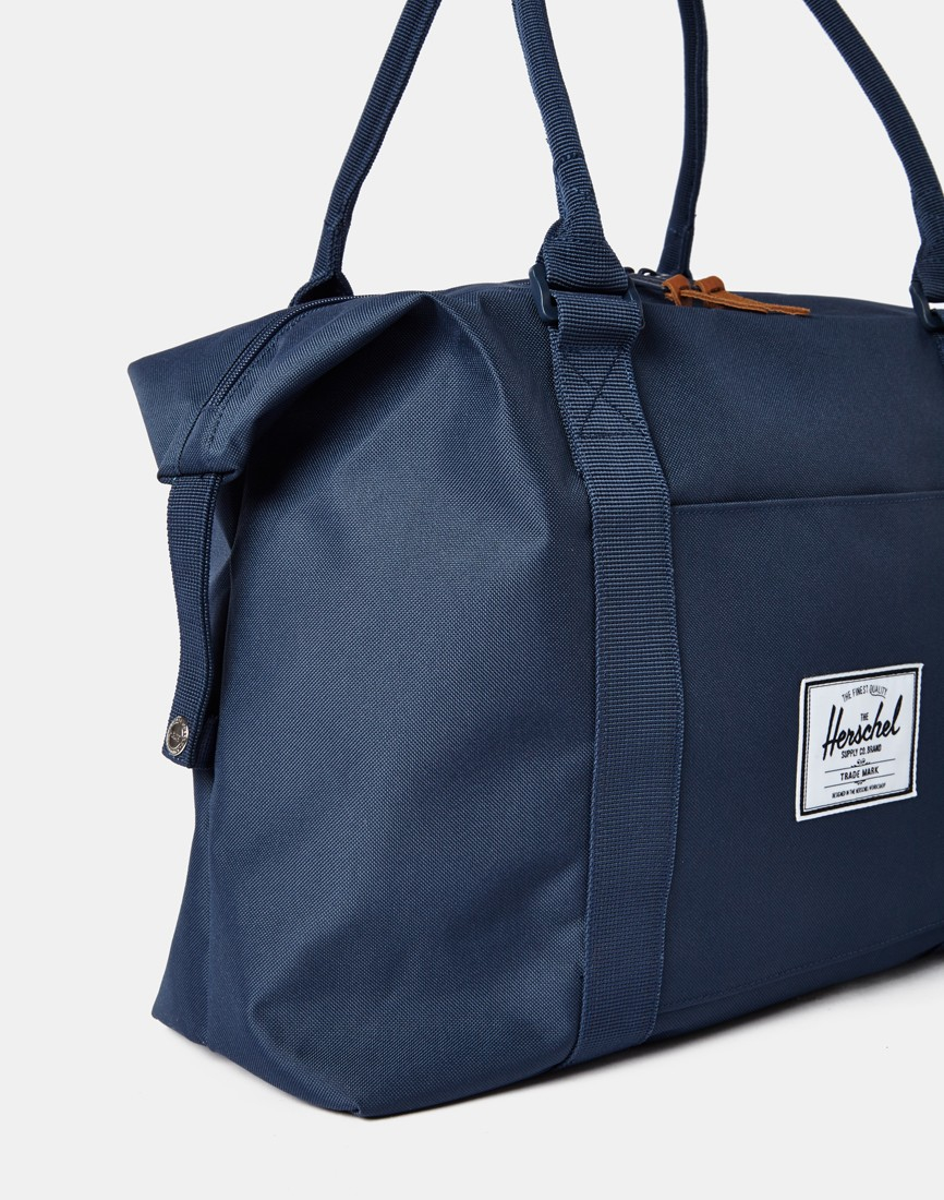 684fde9e19c Lyst - Herschel Supply Co. Supply Co. Strand Duffle Bag - Navy in ...