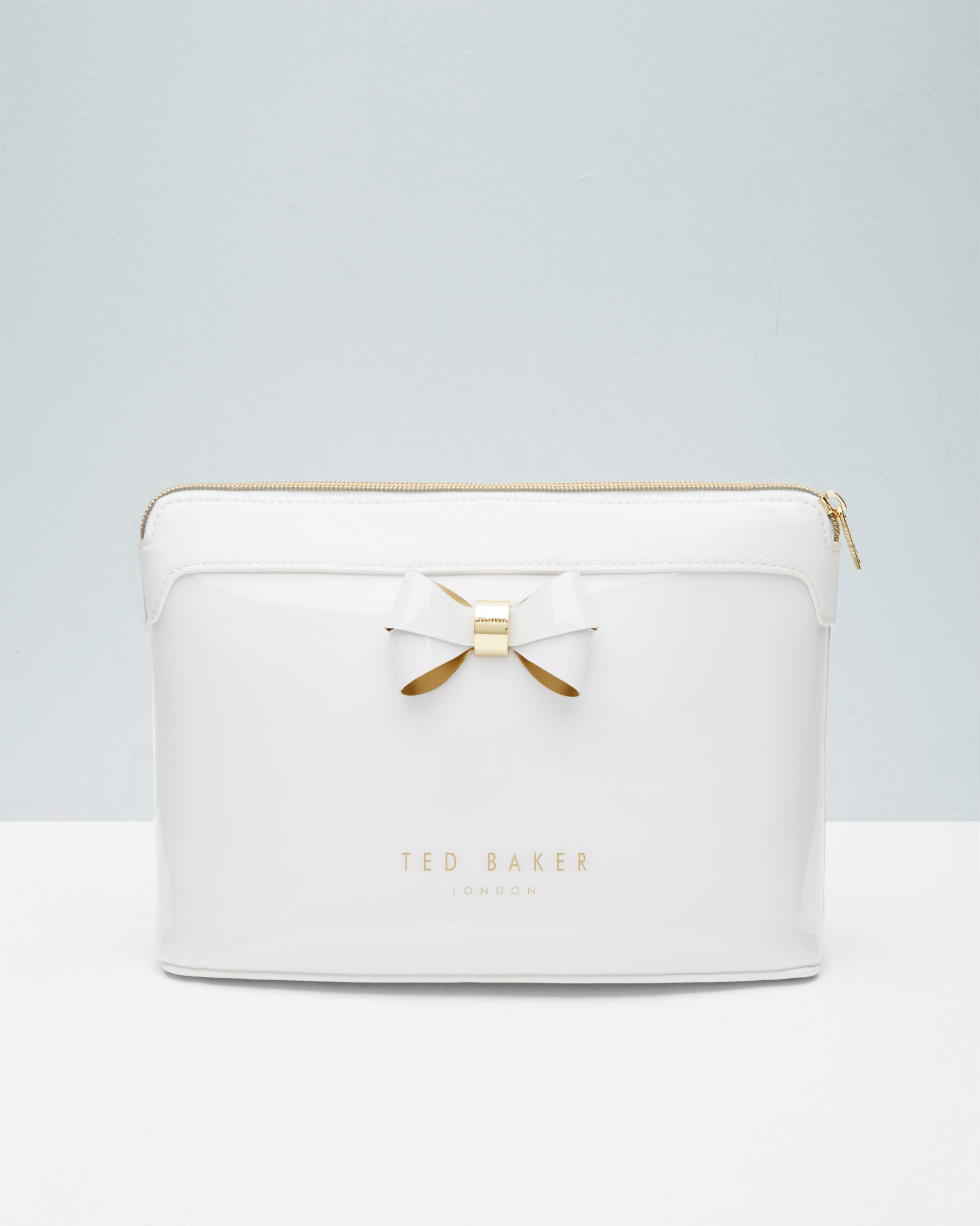 5f55da36136ad Ted Baker Layered Bow Wash Bag In White For Men Lyst