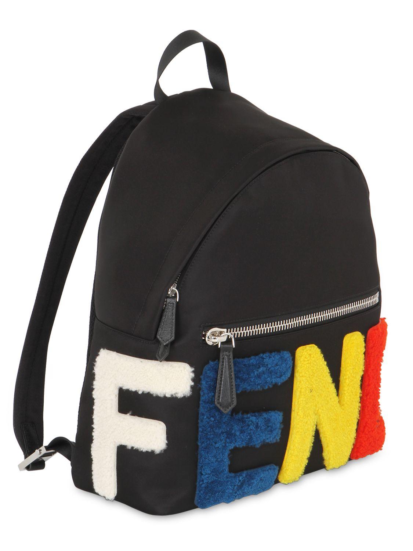 ced4b27d3aa ... Lyst - Fendi Logo Patches Nylon Shearling Backpack in Black buy popular  9b80d a6fb7 ...