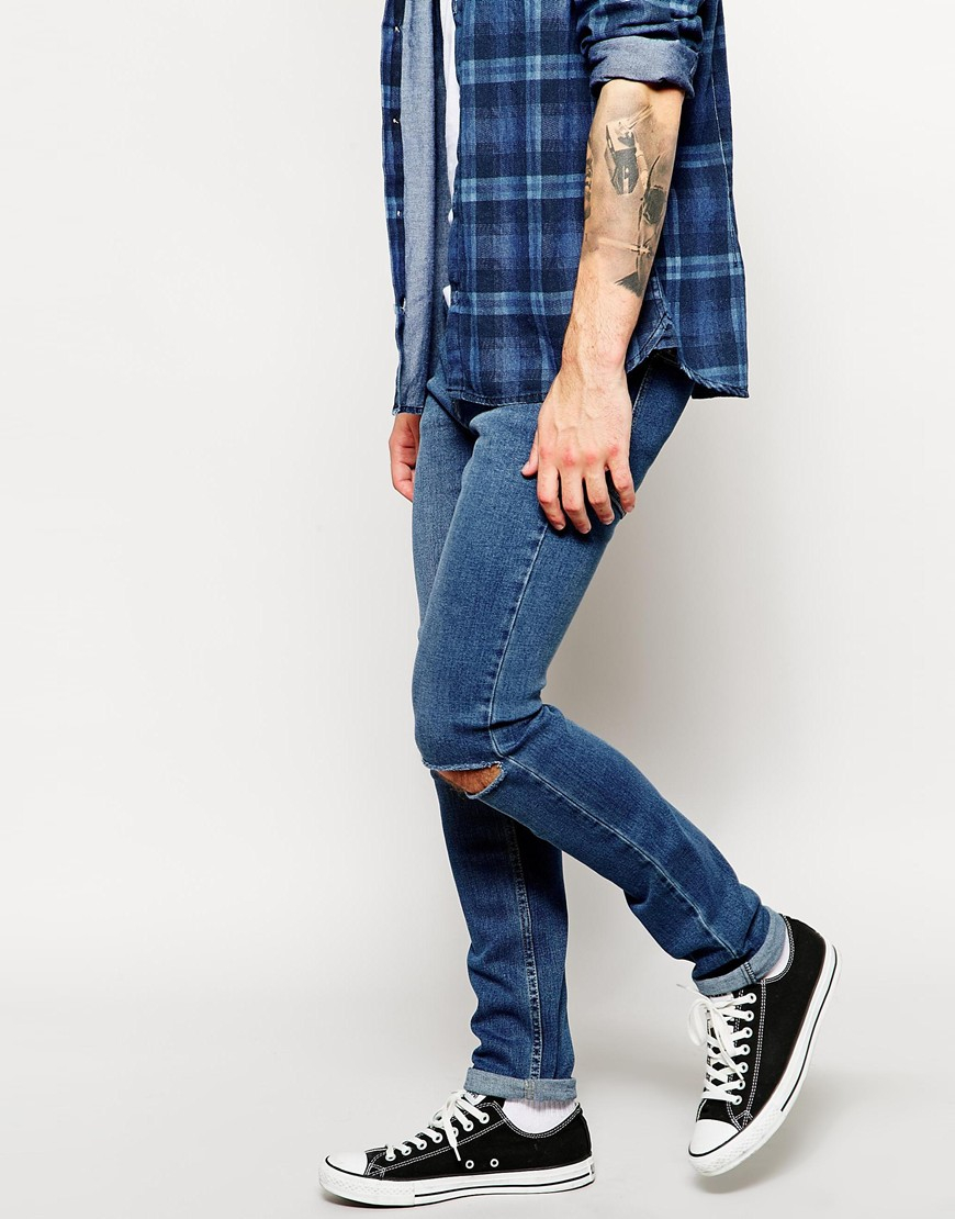 Cheap monday Exclusive Tight Skinny Jeans With Ripped Knee in Blue