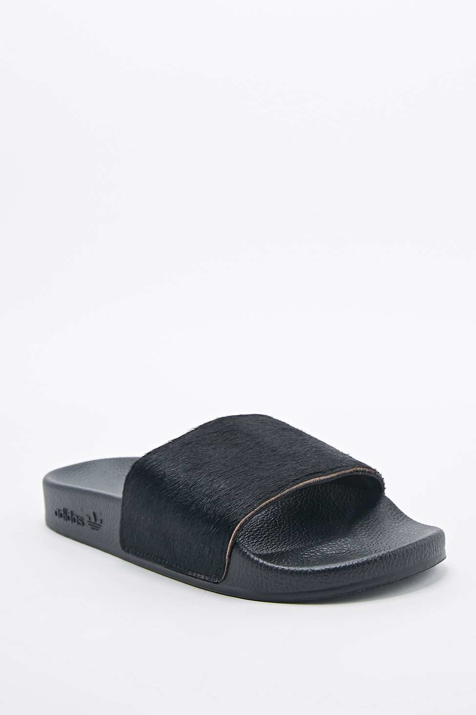 more photos d1d60 d2fba adidas Adilette Lux Pony Sliders in Black - Lyst