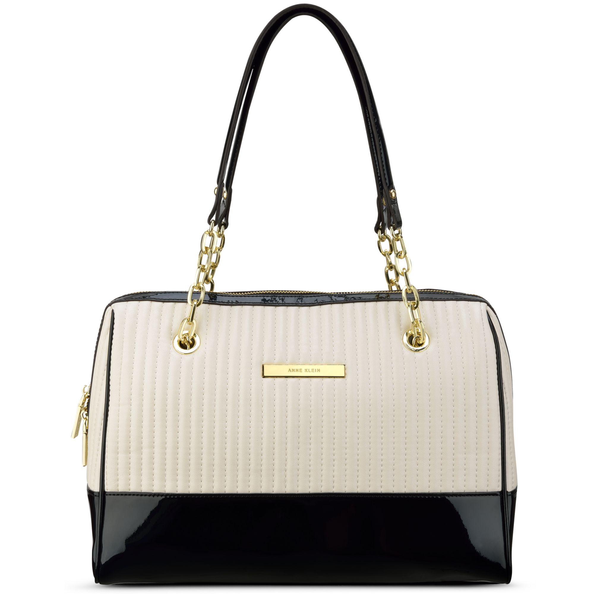 97d8876bdb7 Lyst - Anne Klein Change The Channel Medium Duffle Bag in Black anne klein purses  macys